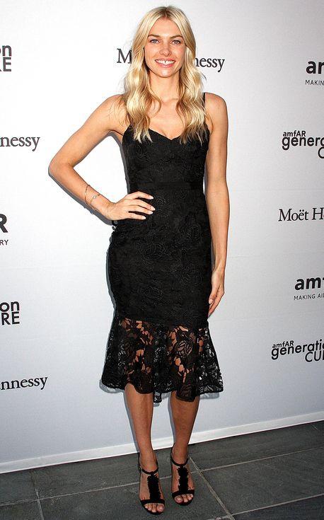 Jessica Hart in a black lace midi dress