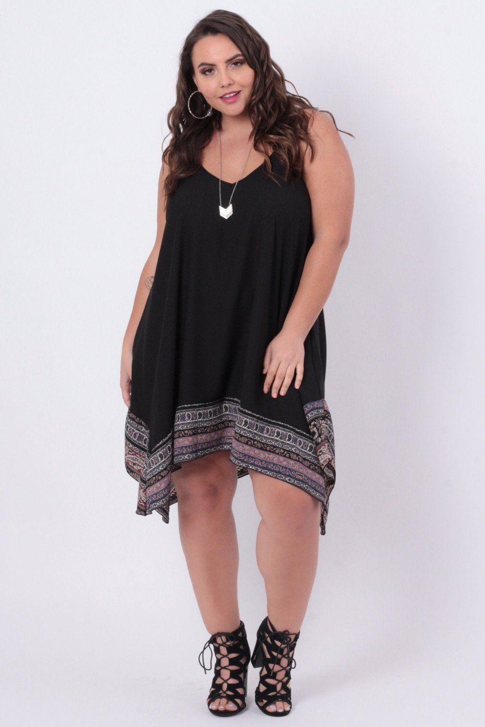 This plus size, soft woven trapeze dress features a v ...