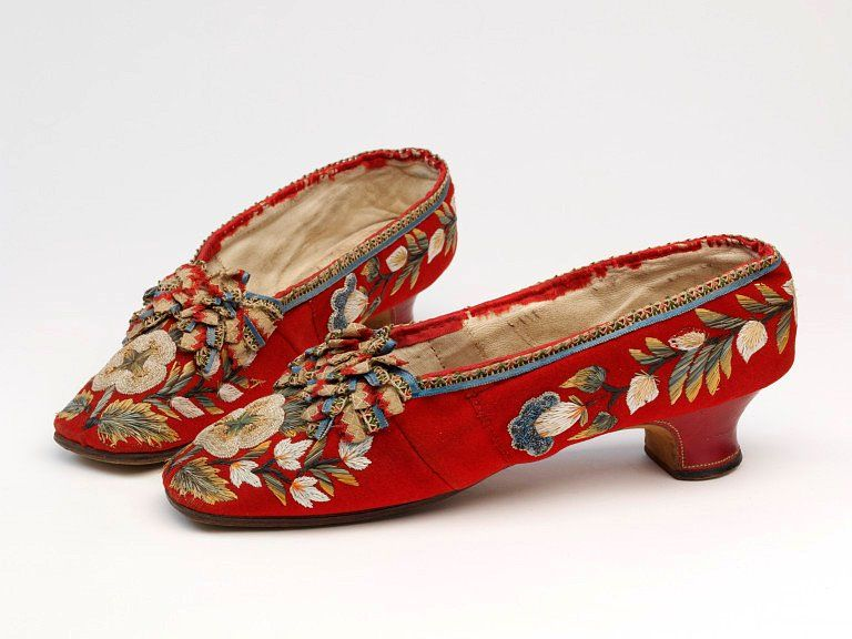 Red wool with red leather covered Louis heel and Native American moosehair embroidery depicting colorful flowers. Circa 1850-75. (V&A)