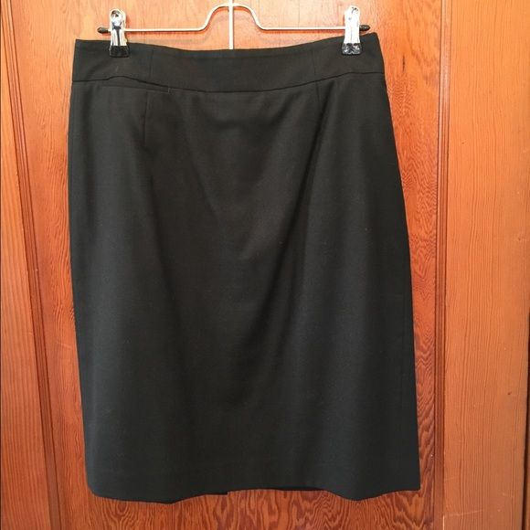 J. Crew Black Pencil Skirt Gently loved and only ever dry cleaned. Classic pencil skirt. 100% wool with polyester lining. Slit in back. J. Crew Skirts Pencil