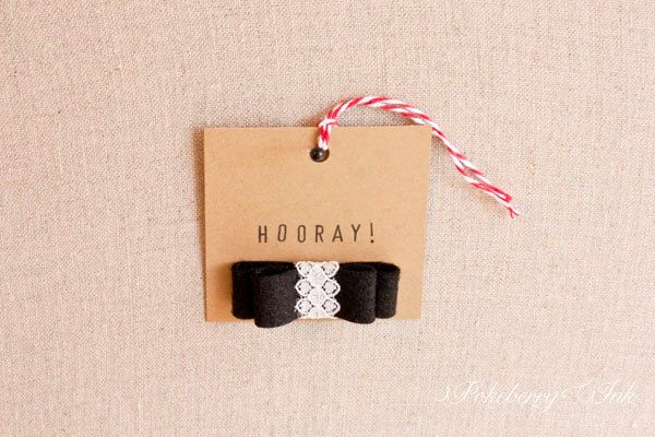 The perfect mix of rustic, fancy, and vintage- Kraft paper gift tag with black felt bow tied with vintage lace. Set of 5 for $10 on Etsy by Pokeberry Ink Press.