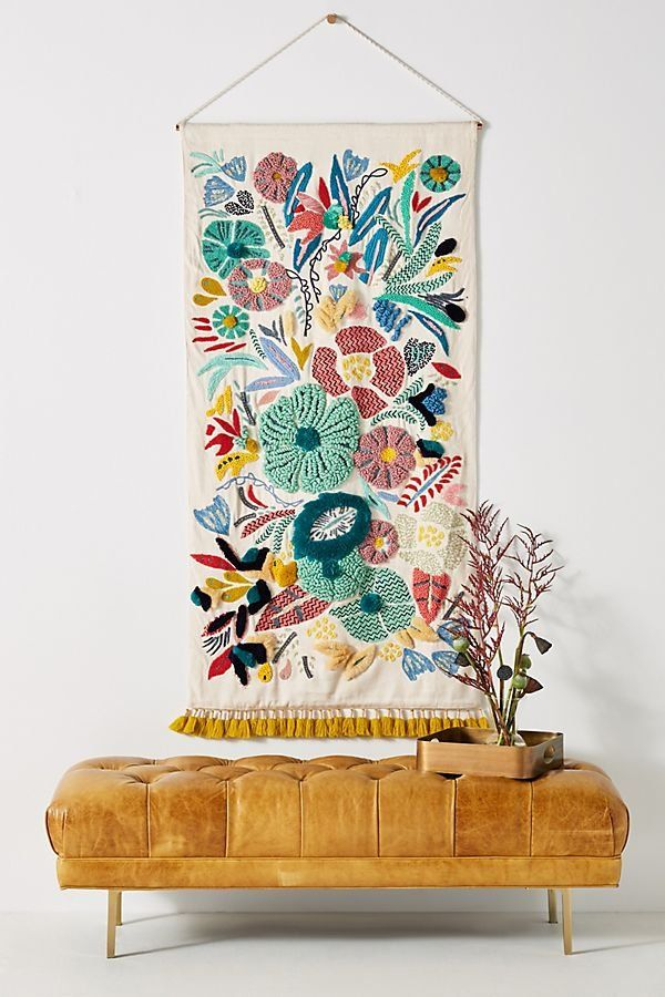 Featuring hand-embroidered detailing and a luxe fringed finish, this stunning wall hanging is an eye-catching piece above a couch, bed, or anywhere you'd like vibrant visual interest.