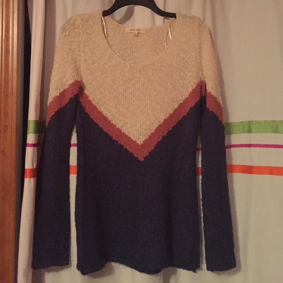 Cute knit V-lined sweater!! Only worn once and in good condition. Very soft thin knit material! Has a nice cream color on top and also a rusty orange color that makes the V shape and a navy blue on the bottom. It's size M (I'm a size small and it fits me nicely, just a little loose) Pink Rose Sweaters Crew & Scoop Necks