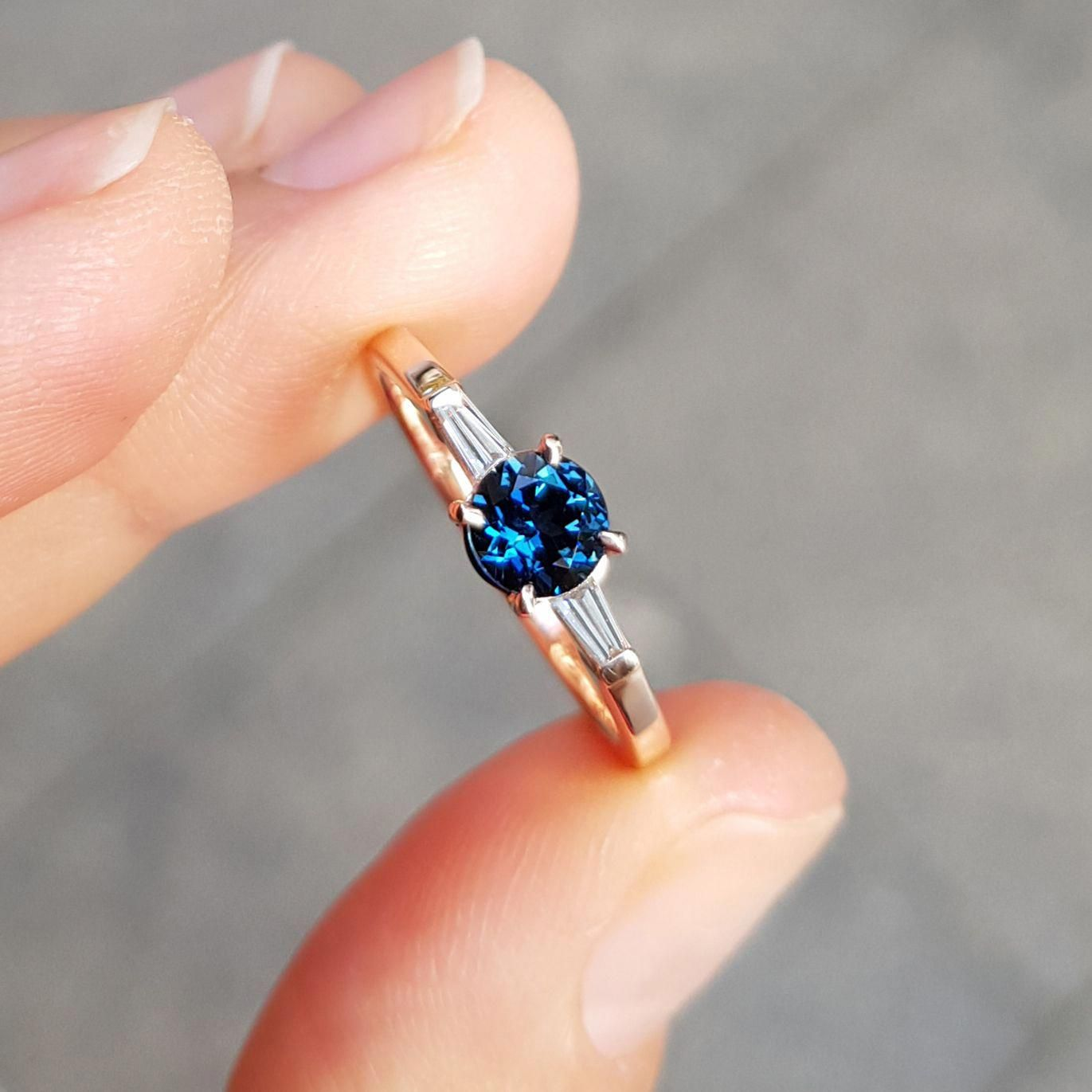 Teal sapphire and diamond engagement ring in rose gold by