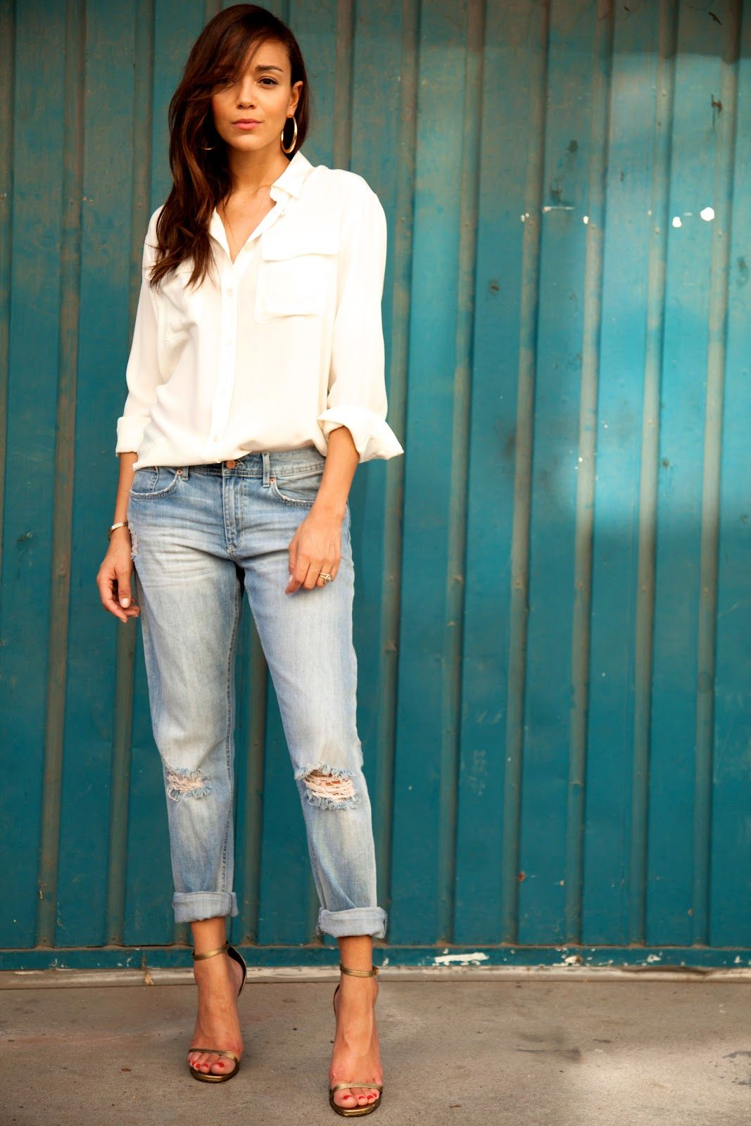"""""""There's something about the juxtaposition of a relaxed, loose fit pair of jeans with a killer pair of heels that just feels right."""" -Actress Ashley Madekwe, in light blue distressed H&M jeans. 