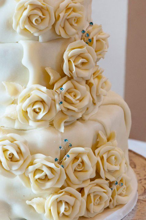 White Belgium chocolate rose, wedding cake with different flavoured tiers.