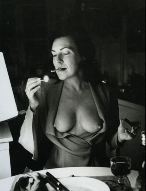 "by Helmut Newton of his wife June  ""We lived in Paris, we had an apartment in the Marais. We were having dinner at a bistro in the neighborhood. Helmut finished eating he asked me, 'June, you can open the?', Indicating the jacket. Obviously he had the camera on the table. I opened the jacket quickly. It was very fast."" Adore"