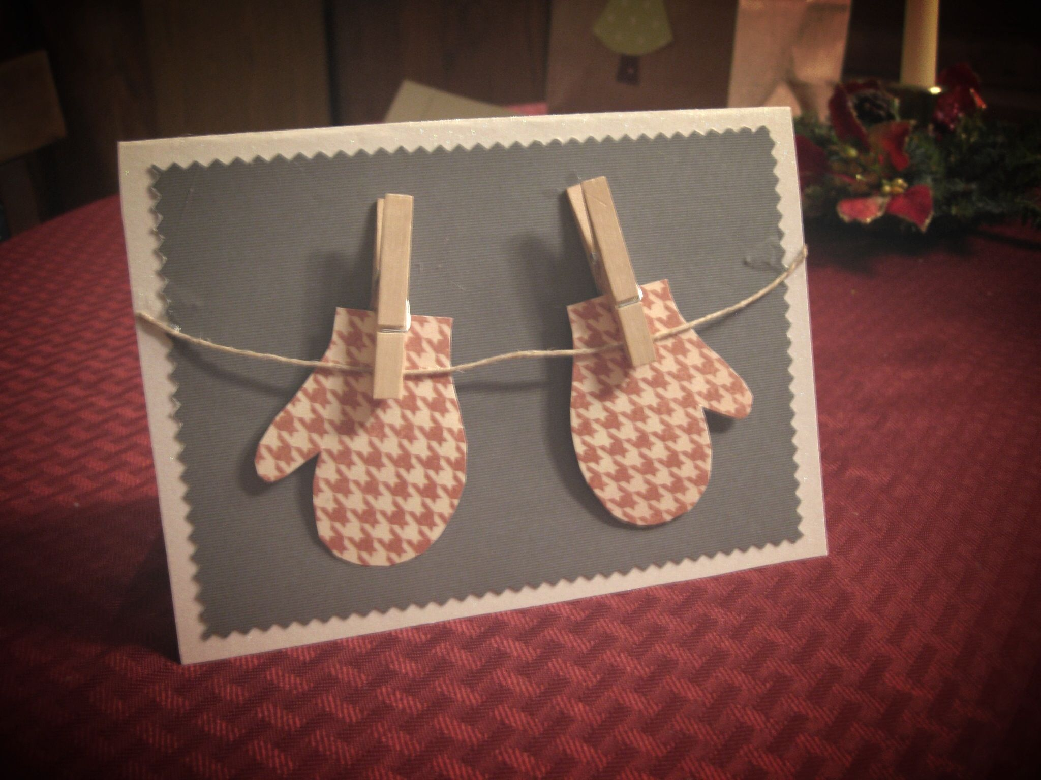 Christmas card with mittens hanging from mini clothespins