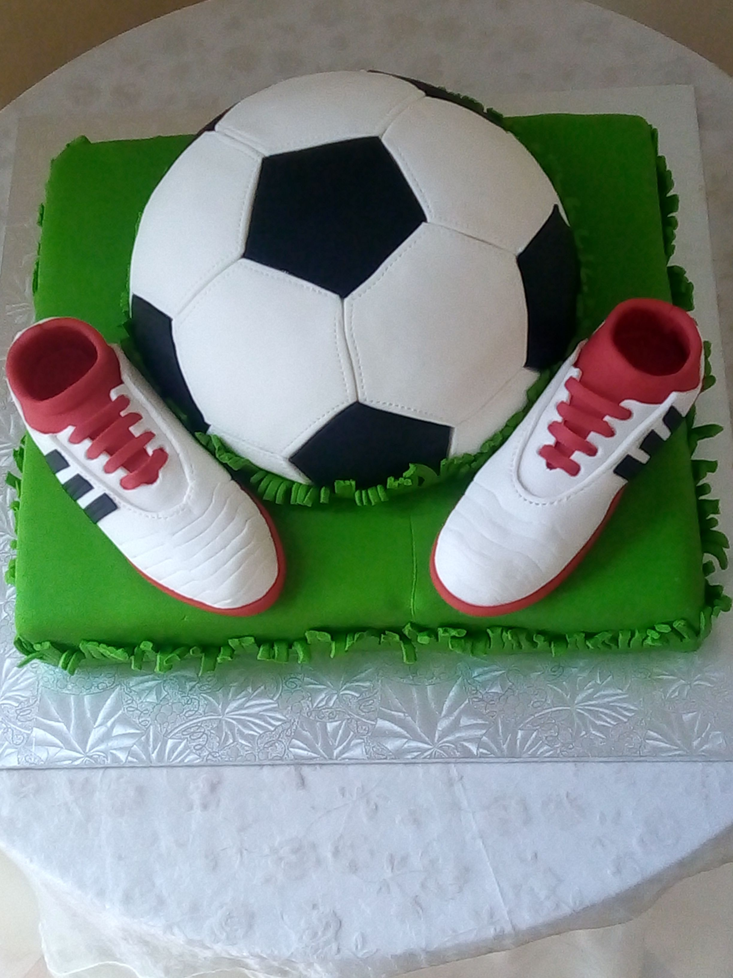 Soccer Cake With Soccer Ball And Soccer Boots Made From Fondant