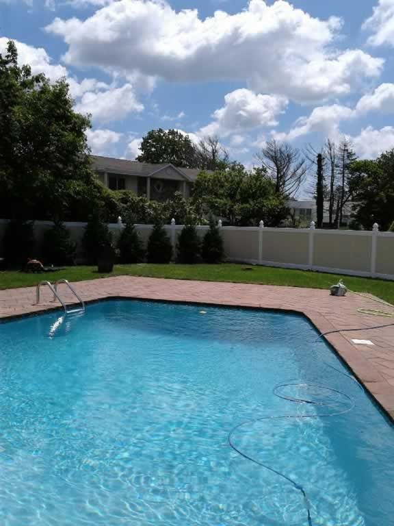Two-tone 72\u2033 Infinity Solid vinyl PVC pool safety fence Tan panels
