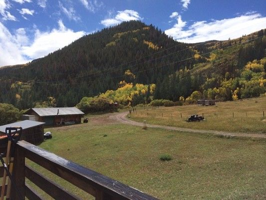 FSBO Glenwood CO - Lovely, Secluded & Quiet Location. Wrap around Deck. Ffinished walk-out basement. Beautiful views of mountains. Corrals & 4 other buildings including a large insulated garage/shop. Adjacent to the White River Natl. Forest with access to 1,ooos of acres. There are water rights & purchase of established outfitting business is possible.  This area is surrounded by mountain hiking & biking, & this property is great for cross country skiing & snowmobiling!!!