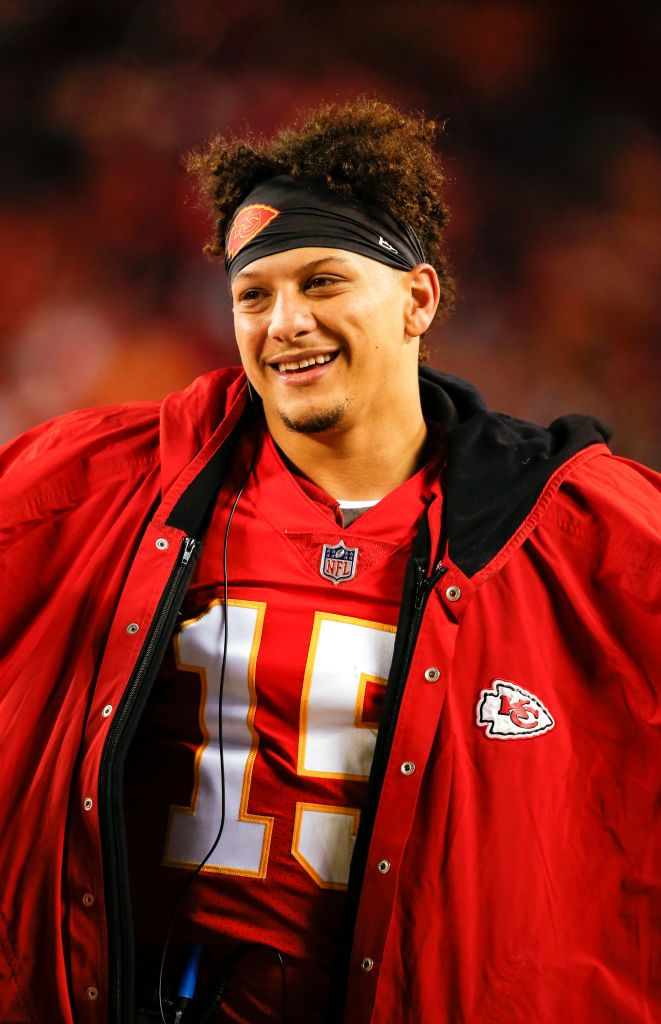 Patrick Mahomes of the Kansas City Chiefs smiles on the bench in the...