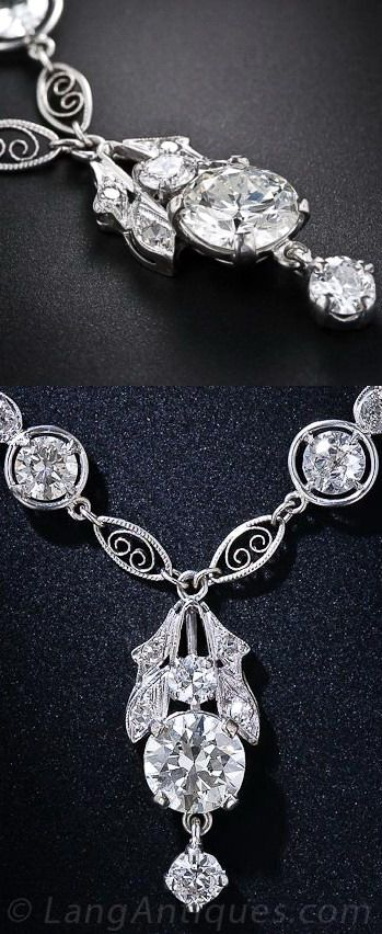 Edwardian Diamond Necklace.  A fabulous and fanciful 17 inch-long diamond necklace culminating in a bright and beautiful 1.75 carat European-cut diamond. This stunning sparkler features twelve larger European-cut diamonds (not including the center stone) framed in 'compass' settings separated by diamond-set teardrops and fancy filigree links. A splendid vintage necklace dating from the early-twentieth century.