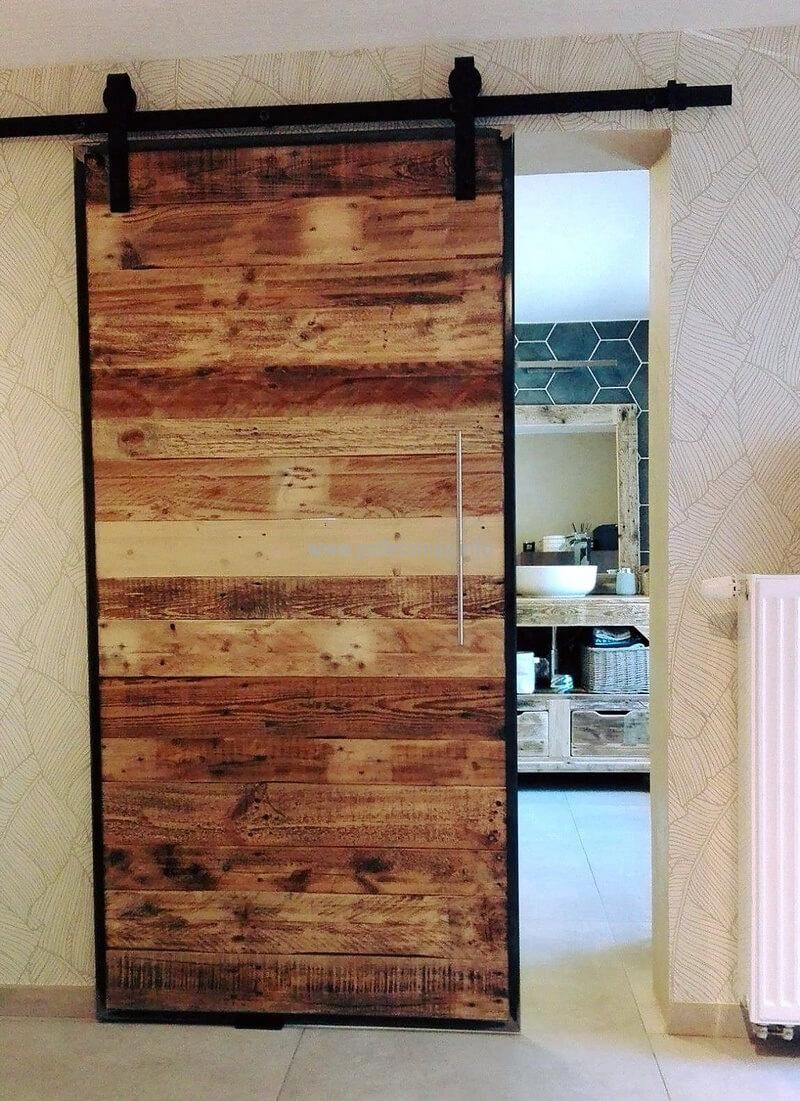 Different Shades Of Wood Pallets Are Fixed In A Random Manner To