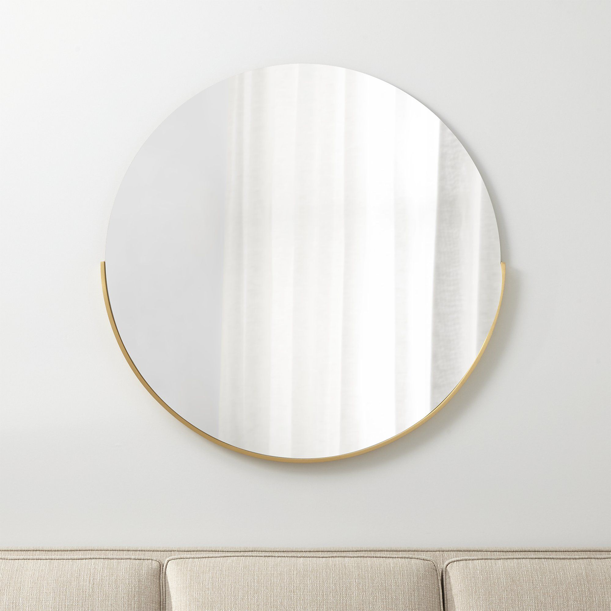 Gerald Large Round Wall Mirror Framed With A Crescent Of Soft Gold Our Statement Making Scales Up The Clean Geometry