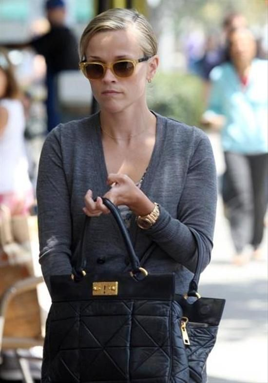 Reese Witherspoon wears Rolex day-date president watch