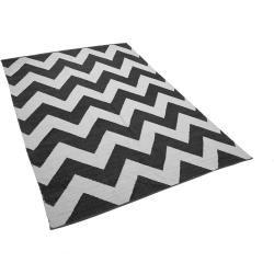 Photo of Alfombra en blanco y negro con patrón en zigzag 140 x 200 cm pelo corto Konarli Beliani