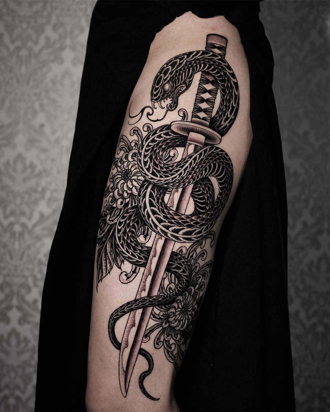 sword and snake tattoo design on hip Snake tattoo design