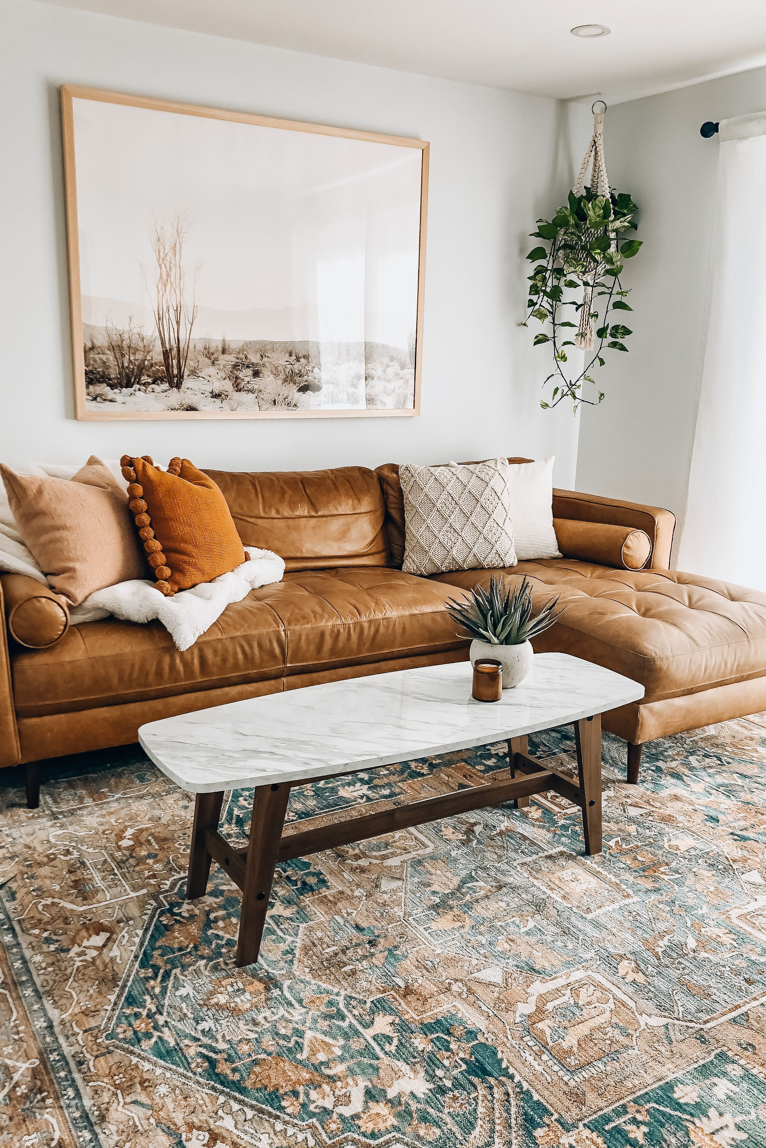 Get the look for your boho living room with plants that won't break your budget. Shop fake houseplants from Afloral.com. Image by @boneill_athome #fakeplants #homedecor #article #budgetdecor