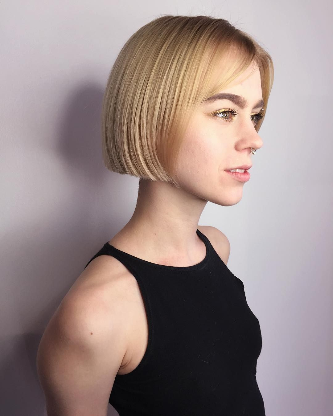 Short Blonde Blunt Bob With Parted Bangs The Latest Hairstyles For Men And Women 2020 Hairstyleology Blunt Bob With Bangs Blunt Bob Short Hair Styles