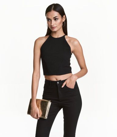 Black. Short top in woven fabric. Narrow-cut at top, short, narrow shoulder straps, and concealed back zip. Lined.