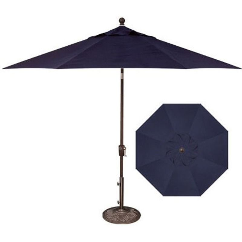 Sleek and practical: This navy blue umbrella is mold- and fade-resistant. Navy 10Ft Auto Tilt Umbrella | Weekends Only Furniture and Mattress