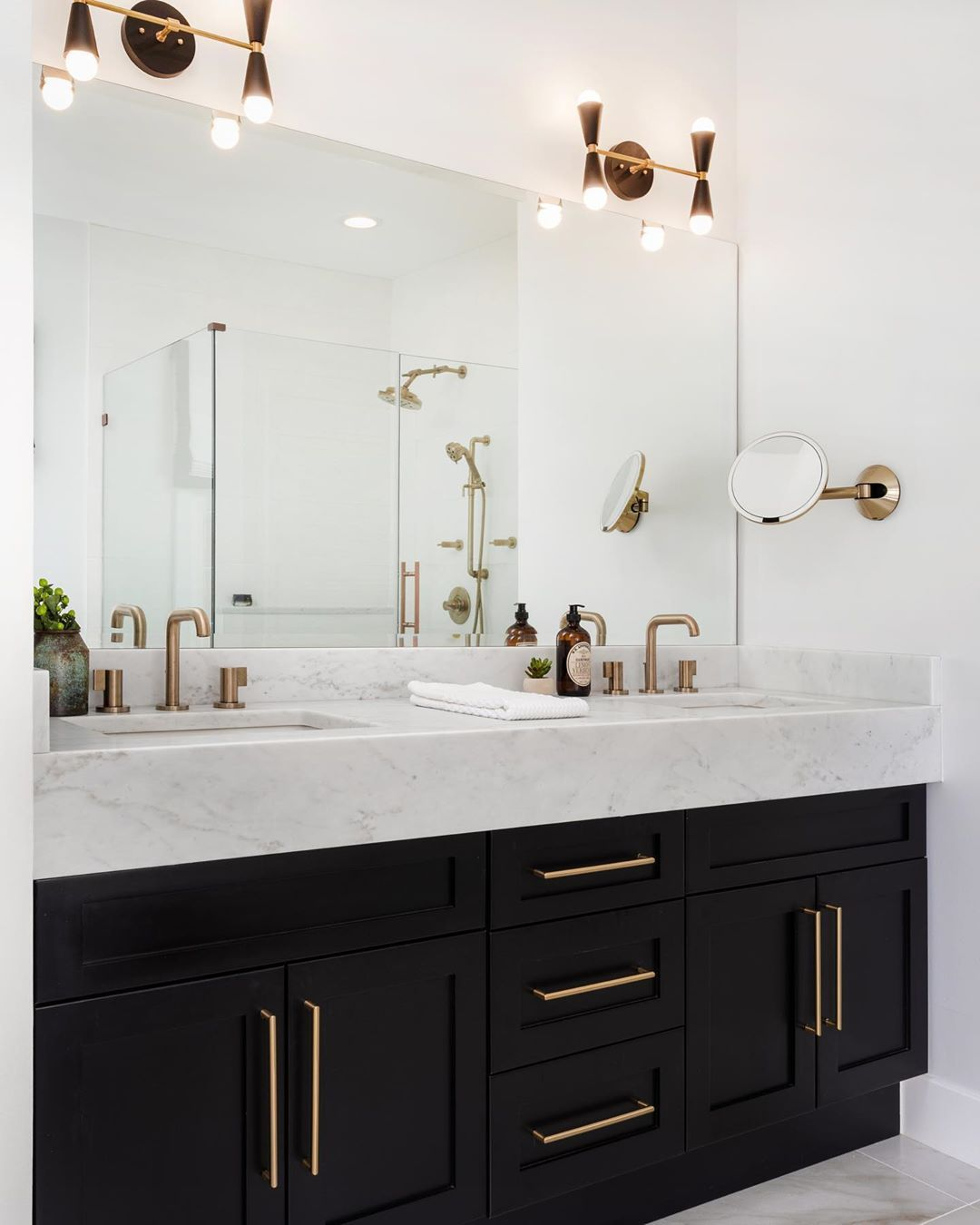 Devon Grace Interiors On Instagram Proof That You Can Still Have A Light And Airy Ba In 2020 Bathroom Interior Design Black Cabinets Bathroom Bathroom Remodel Master