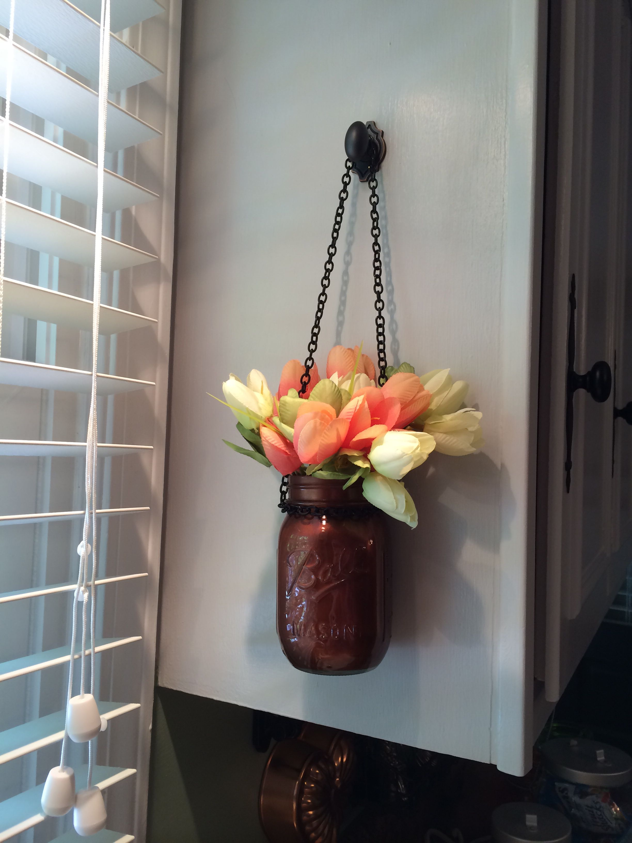 Hanging mason jar with flowers