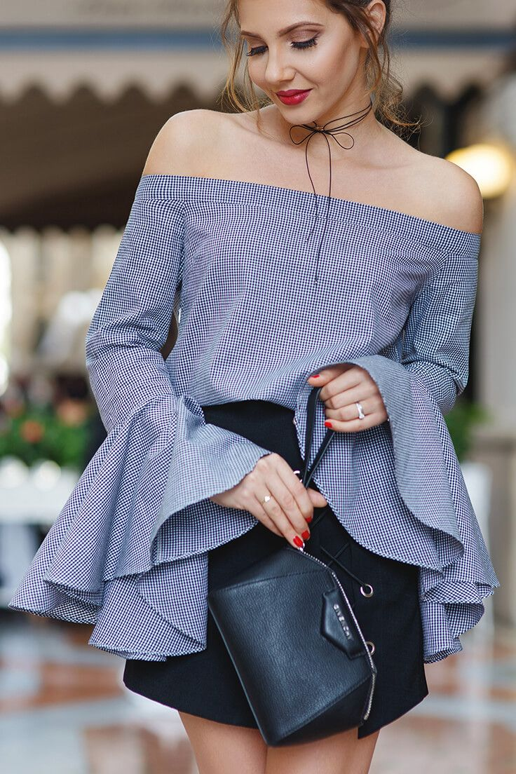 5652e89bf78 If it's drama you want, look no further than this gray bell sleeve blouse  and black lace-up mini ...