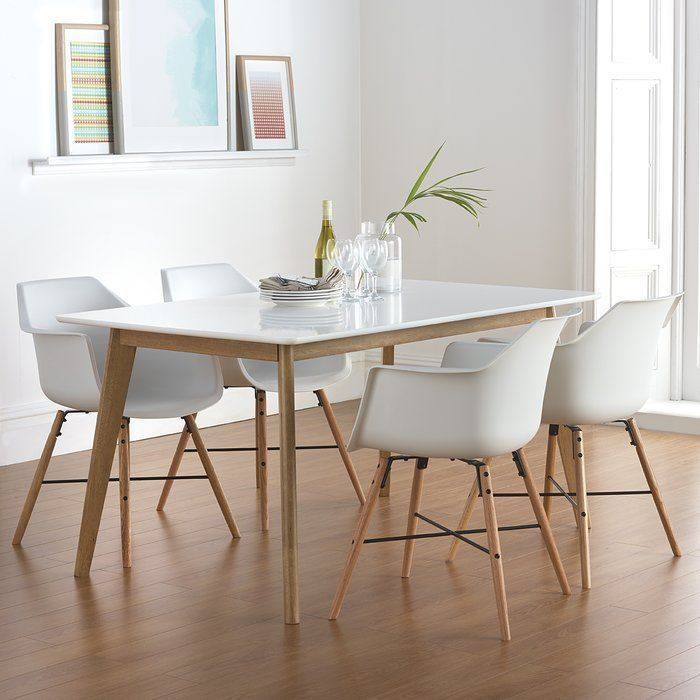 The Calhan Dining Table Is A Perfect Mixture Of Minimalist And Sophistication With Its Clean White Matt Lacquered Top Hardwood Oak Stained Legs