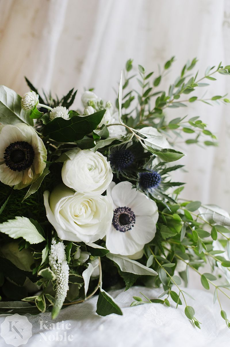 Simple And Elegant Flower Bouquet Black And White Anemones White Roses Blue Th Blue Flower Arrangements White Flower Arrangements White Floral Arrangements