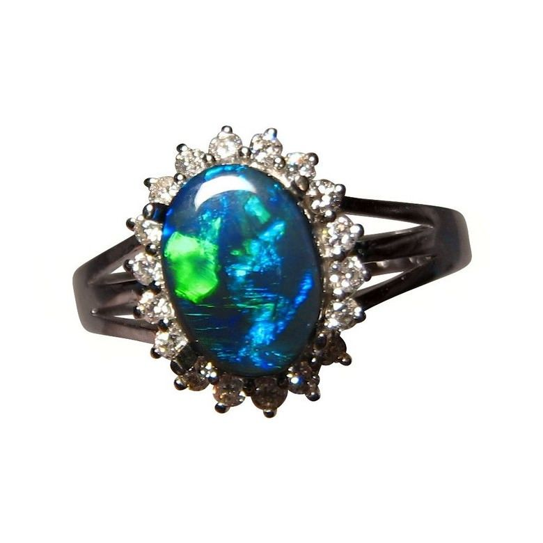 A stunning Black Opal ring with a halo of quality Diamonds in 14k Gold.
