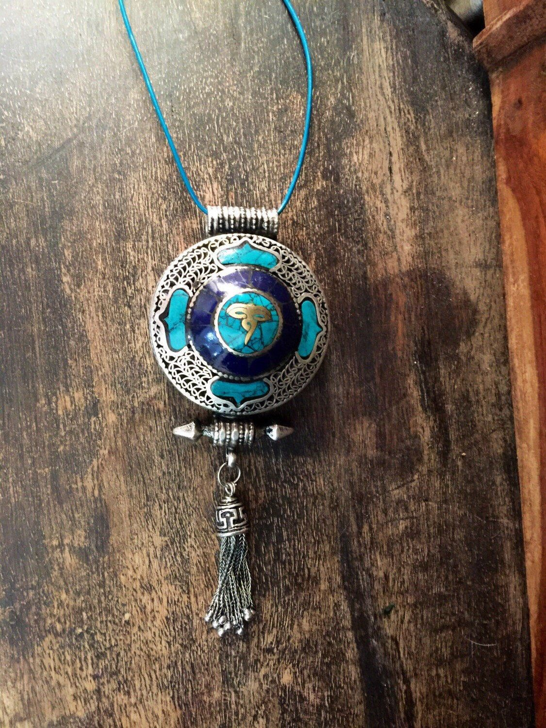 A personal favorite from my Etsy shop https://www.etsy.com/listing/465734912/ethnic-necklace-budhist-prayer-box