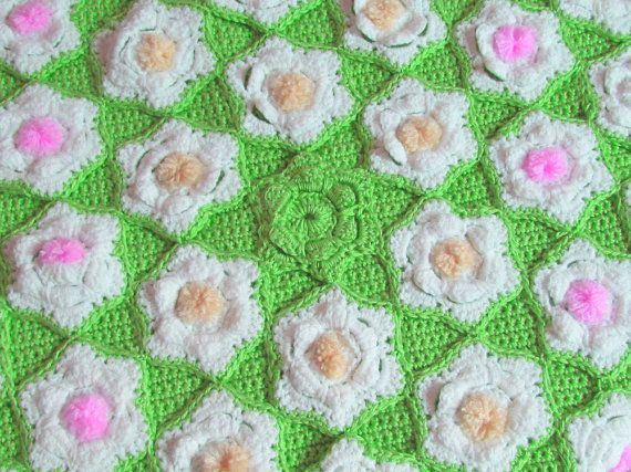 Flower Afghan Crochet Throw Blooming Flowers One of a by knitwhats Beautiful handmade crochet flower afghan where each blooming flower is an individually made crochet motif, then sewn onto a seperate handmade crochet blanket for the background. Made from soft yarn. It is a one of a kind.  The afghan looks like a springtime field of flowers. Some flowers have a middle of pink, yellow or white pom-poms to add a touch of color. The petals are made to stand apart from the base of the flower. Lo