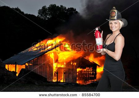 A Beautiful Woman Firefighter At A Fire Stock Photo 85584700 ...