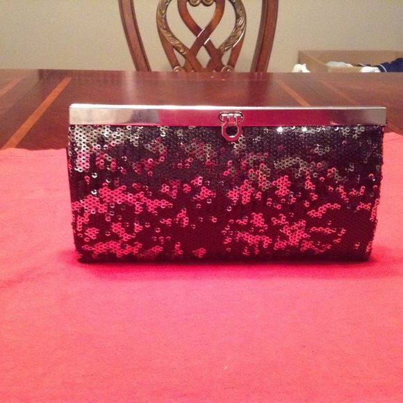 FORMAL Clutch Great clutch for that special formal occasion. Stylish in black with just enough sparkle to enhance your gown. The size is 4H by 7.5.  This item is in Good condition, Authentic and from a Smoke And Pet free home. All Offers through the offer button ONLY. I Will not negotiate Price in the comment section. Thank You Bags Clutches & Wristlets