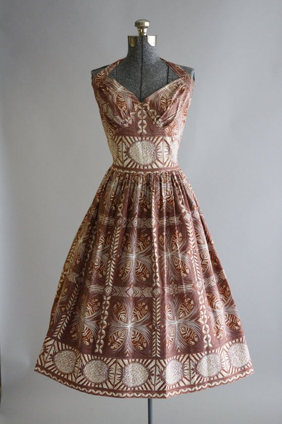 bc6a24ad82f This 1950s cotton halter sun dress features a Hawaiian style pineapple print  in shades of brown