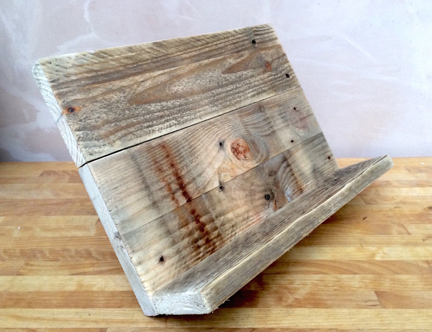 A handmade cookbook or tablet stand made from reclaimed