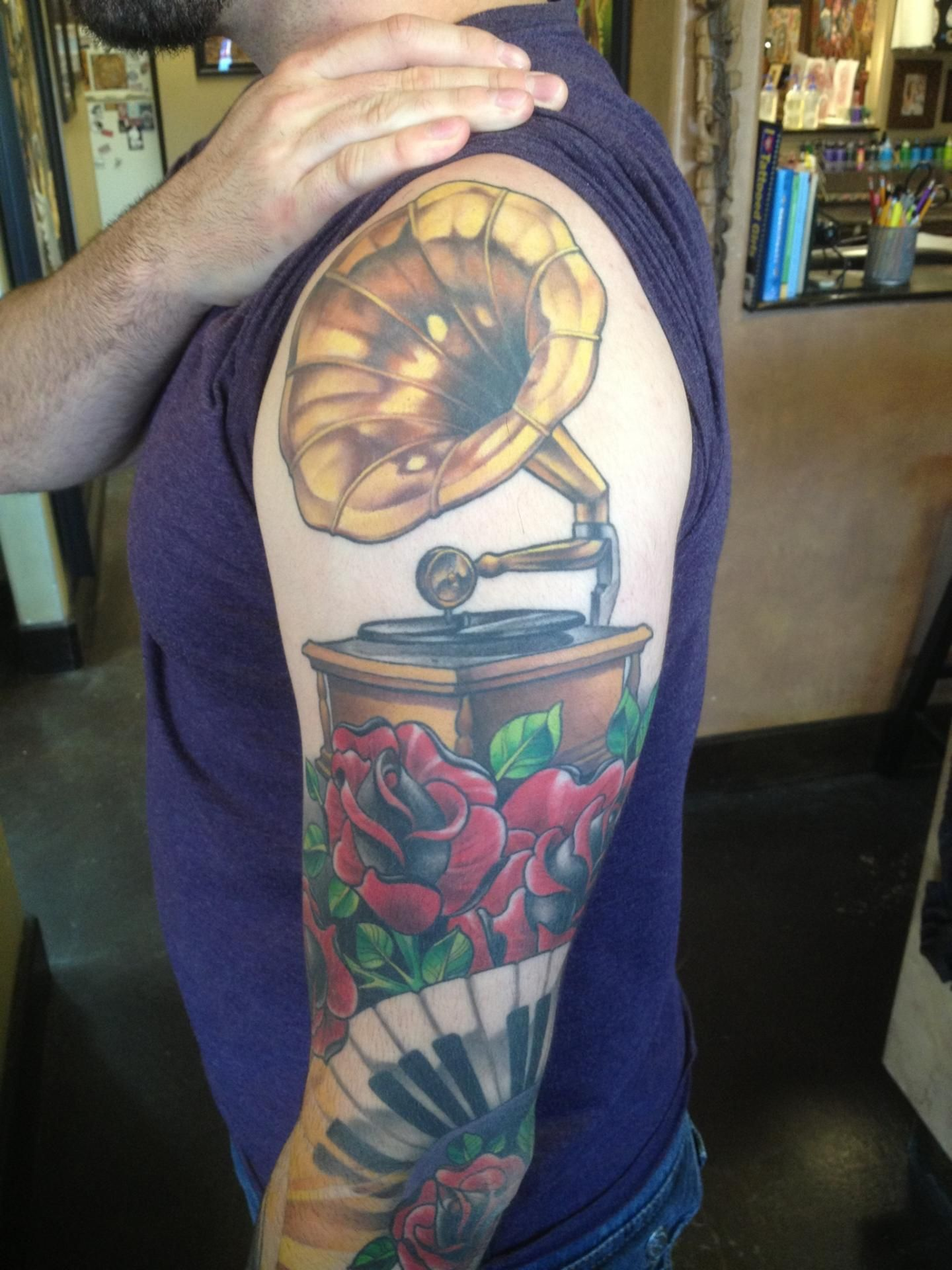 Phonograph tattoo by Kevin Dickinson Guru Tattoo San