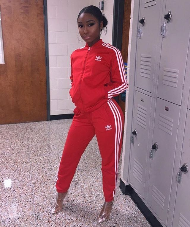 Esyonce. All red adidas track suit with clear plastic ankle