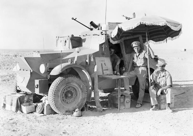 Morris armoured car crew showing initiative in the Libyan desert, autumn 1940 - probably a Squadron HQ vehicle given the map board and two Officers.