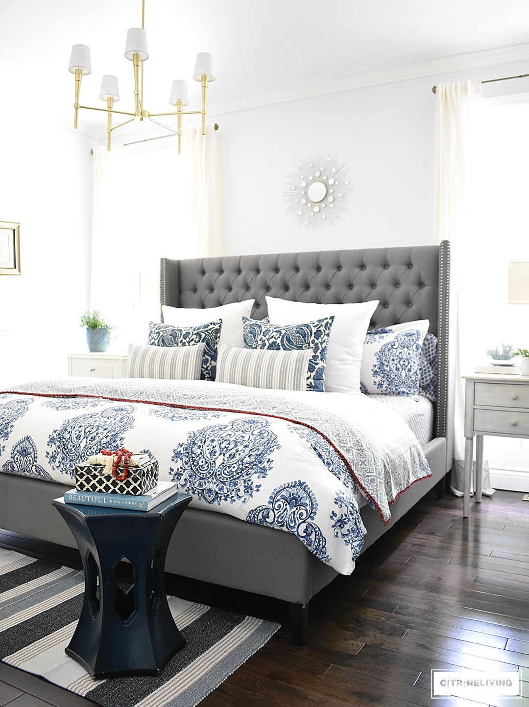Blue and white summer decorated bedroom with layers of bold pattern