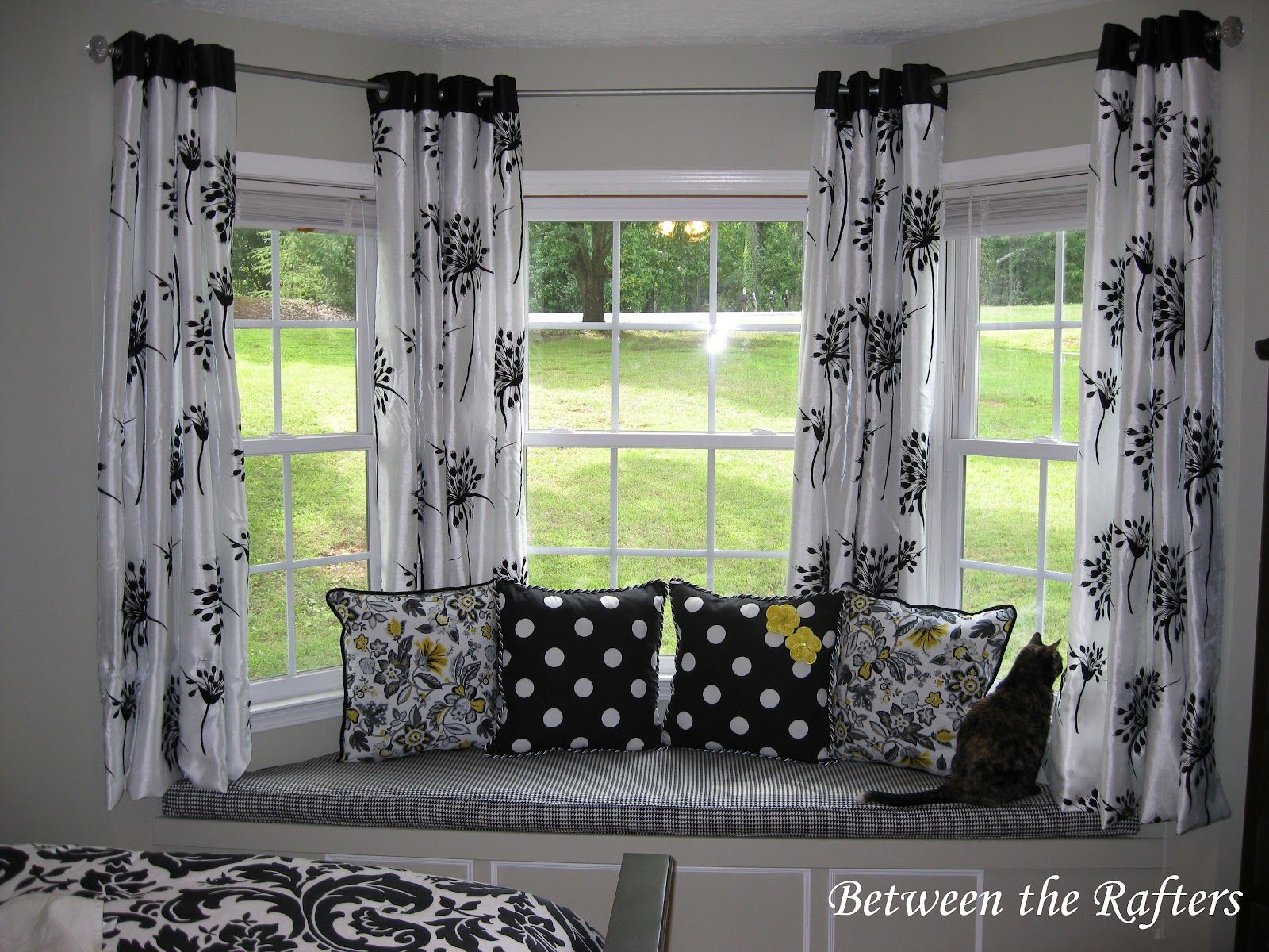 Bay window with window seat treatments - Between The Rafters Do It Yourself Bay Window Curtain Rod Tutorial