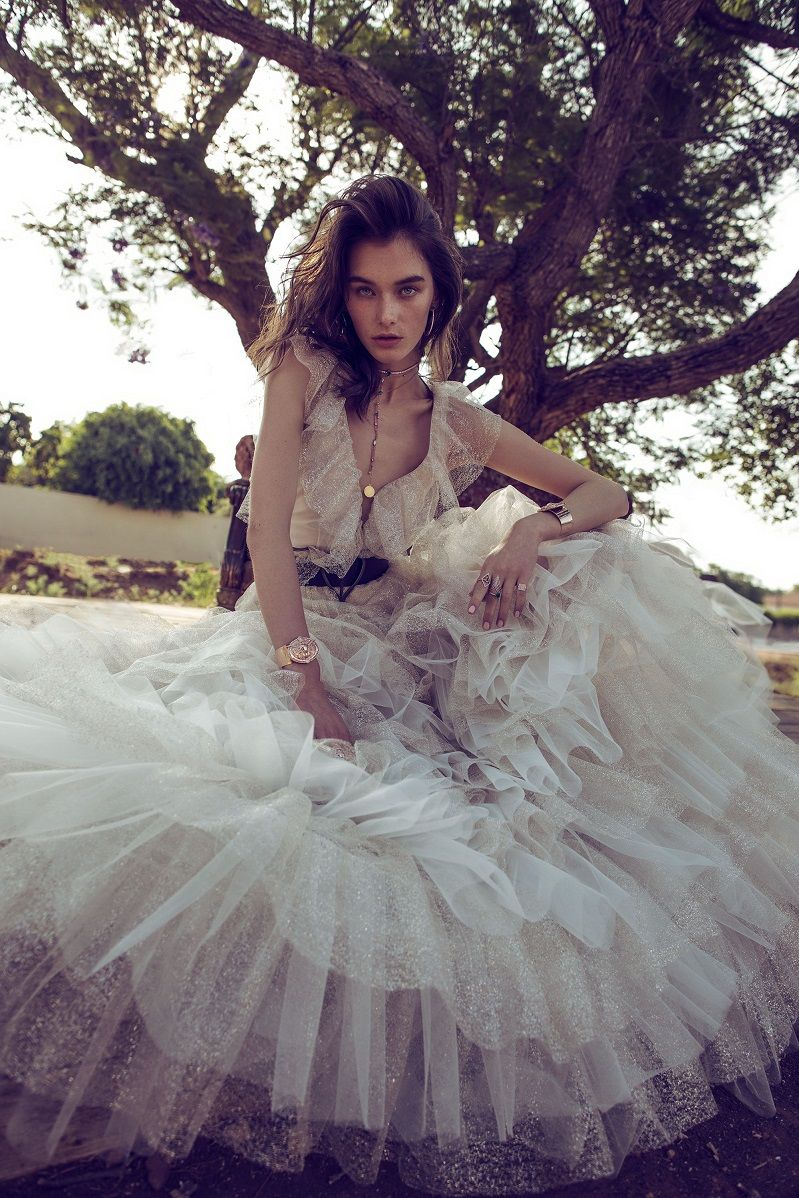 Pleated sparkles tulle with large ruffled shoulders, V plunge with illusion net on middle. dramatic layered gold and ivory tulle skirt. ball cut Layered a line wedding dress #wedding #weddingdress #weddinggown