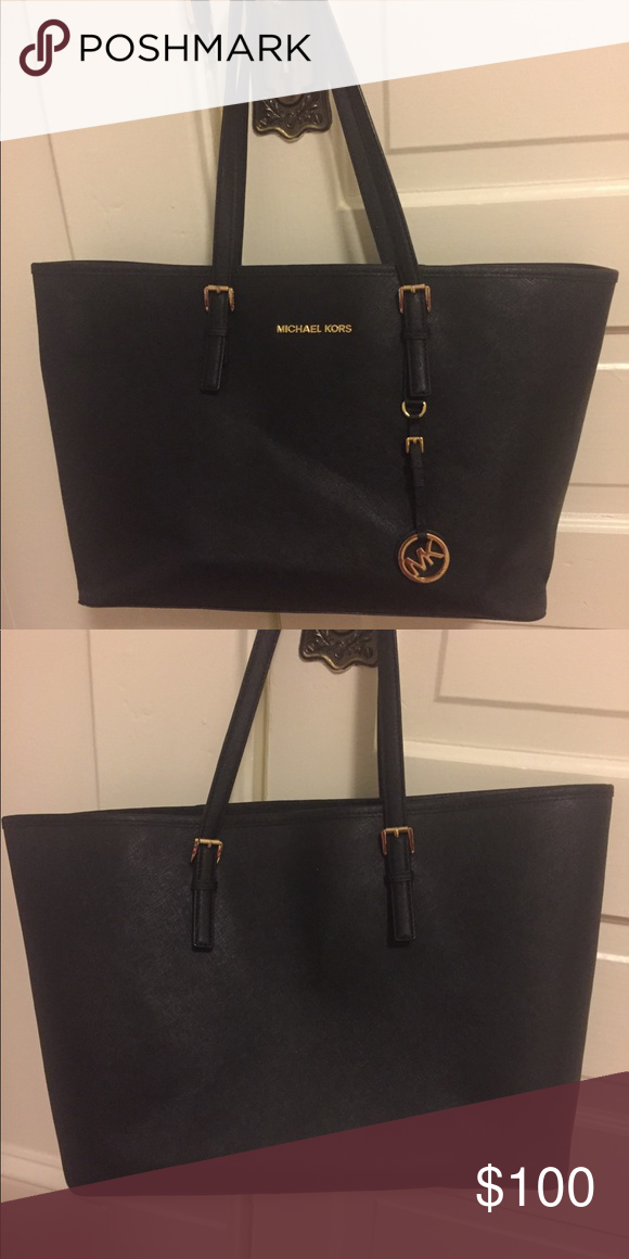 586de5a28d2183 Michael Kors Jet Set Travel Tote Black leather tote bag with Michael Kors  logo and charm, great condition, just one scratch on the side Michael Kors  Bags ...