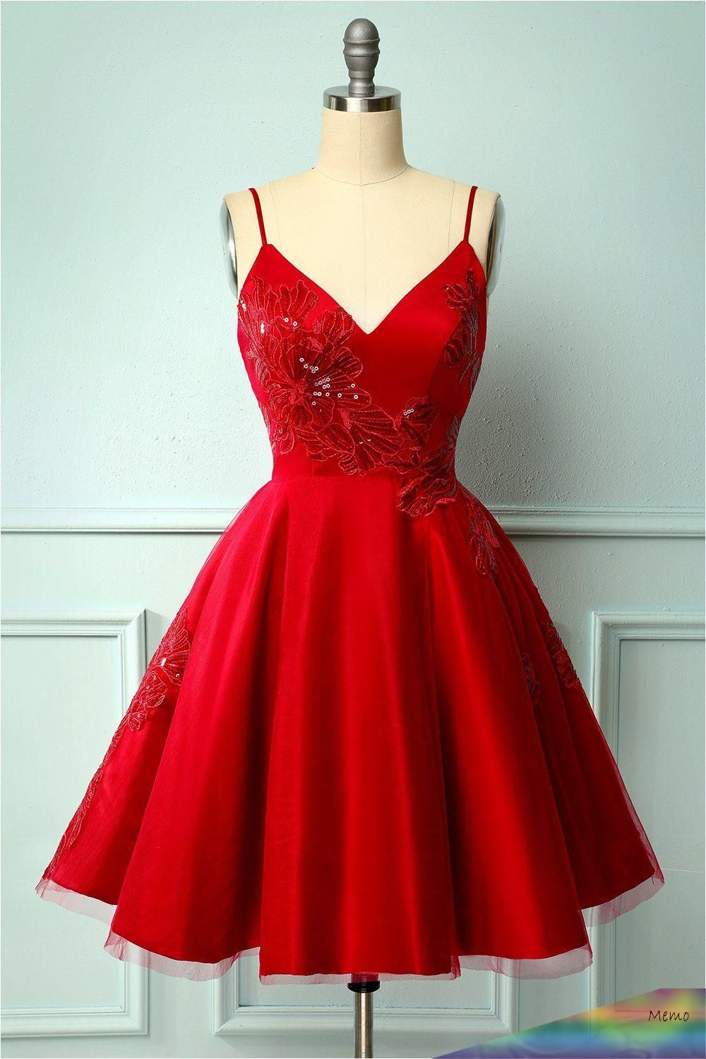 stylish and unique, this red dress embroidered with a floral