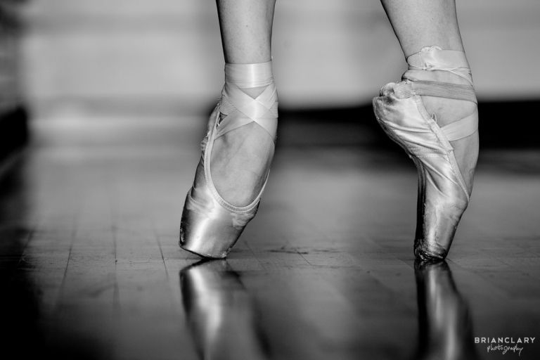 Worn ballet slippers black and white