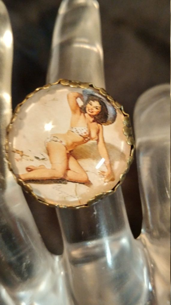 Hey, I found this really awesome Etsy listing at https://www.etsy.com/listing/476683587/kitchy-pin-up-girl-brass-adjustable-ring