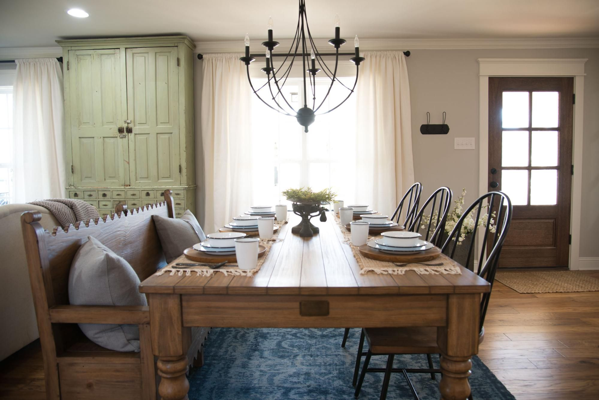 Fixer upper kitchen table decor - The Dining Room Was More Of A Transitional Space From The Entry To The Living Space But It Was Close To The Kitchen And Became The Perfect Area To Hang A