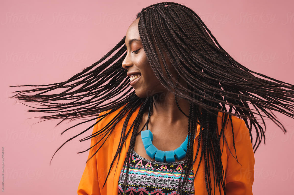 Portrait Of Beautiful Smiling African American Woman With Bradis Stocksy United Portrait Pink Background African American Women
